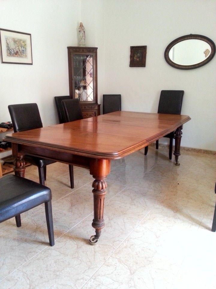 For sale: Very solid large wood dining table - seats up to 10, a metal screw underneath allows it to be extended or made smaller.